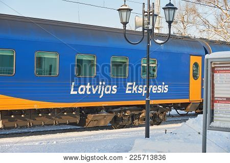 Moscow, Feb. 01, 2018: Winter Day View On Blue Passenger Coach Car Latvian Express At Rizhskiy Railw