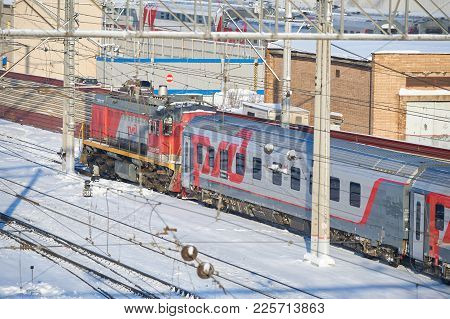 Moscow, Feb. 01, 2018: Winter View On Russian Railway Diesel Locomotive Pulling Passenger Coaches At