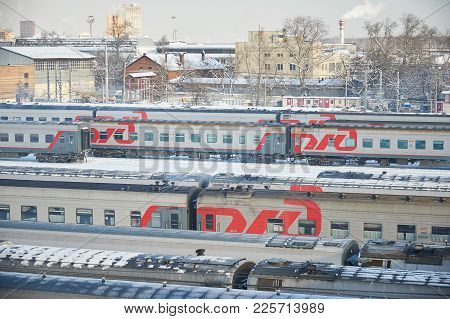 Moscow, Feb. 01, 2018: Winter Top View On Railway Passenger Coaches Cars At Rail Way Depot Under Sno