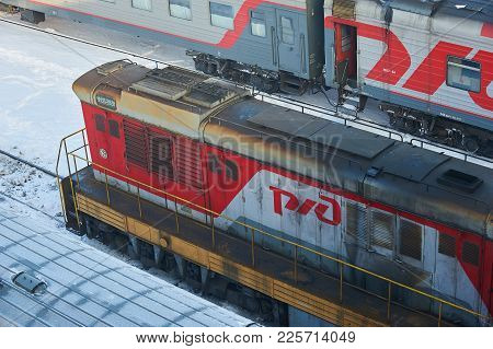 Moscow, Feb. 01, 2018: View On Dirty Diesel Locomotive At Railway Depot In Winter. Railway Dirty Loc