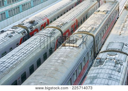Moscow, Feb. 01, 2018: Winter View On Railway Passenger Coaches Cars At Rail Way Depot Under Snow Pa