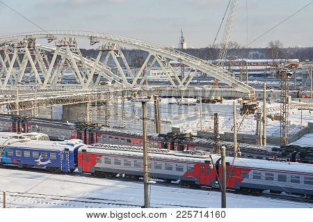 Moscow, Feb. 01, 2018: View On Russian Railways Passenger Trains Running Under New Metal Bridge Unde