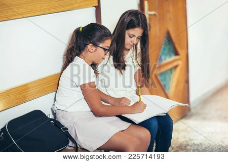 Two Girls Sit In The Hallway School