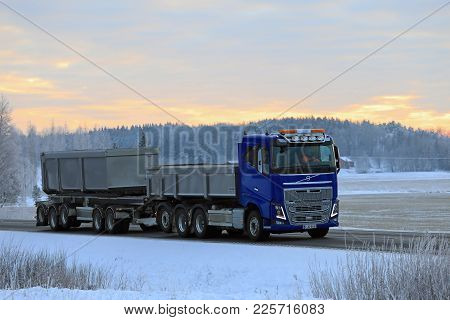 Salo, Finland - January 19, 2018: Blue Volvo Fh16 Gravel Truck Moves Along Rural Highway In Winter A
