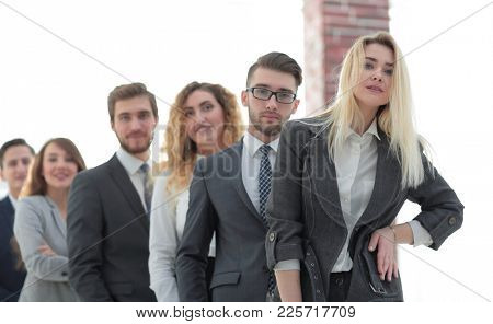 group of young business people standing in a row.