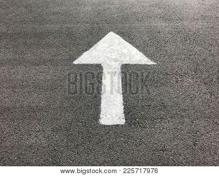 White Arrow Sign On Asphalt Road, Under Sun Light