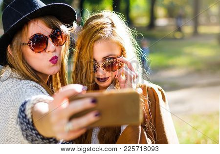 Urban Girlfriends Taking A Selfie In The Park