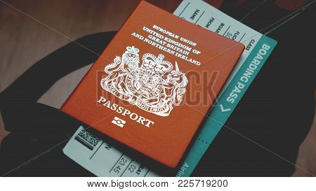 British Passport And Boarding Pass Are On The Top Of Bag Toned Photo
