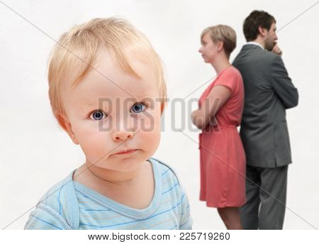 Small Child With A Blue Eyes And Quarreling Parents