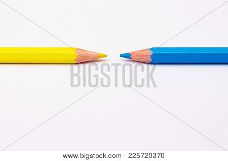 Two Pencils Of Yellow And Blue, Symbolize The Opposite