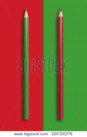 Two Pencils Of Green And Red On A Red And Green Background, Symbolize The Opposite
