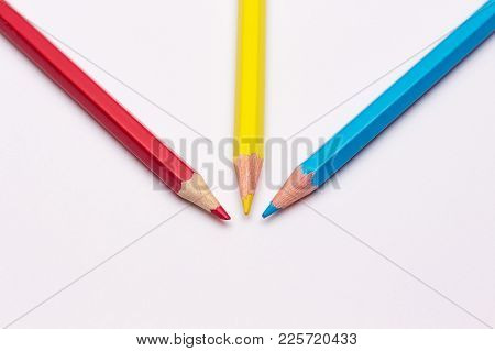 Three Pencils Of Yellow, Red And Blue, The Primary Colors