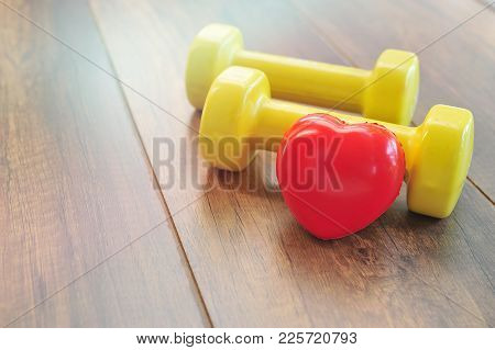 Red Heart And Dumbbell.exercise To Prevent Heart Disease Concept.