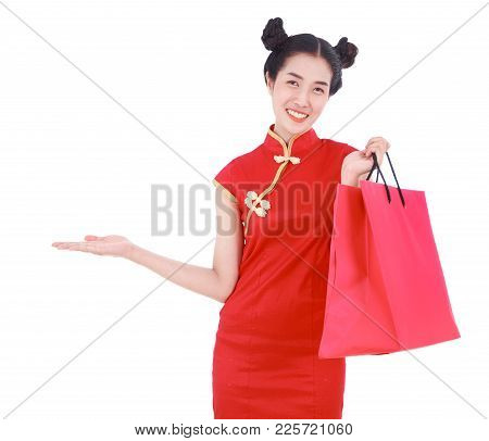 Woman Holding Shopping Bag And Open Hand Palm In Concept Of Happy Chinese New Year Isolated On White
