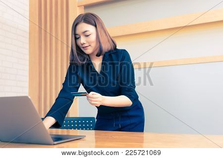 Young Happy Asian Business Woman Holding Credit Card And Shopping Online On Her Laptop Computer, Goo