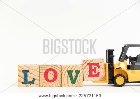 Toy Forklift Hold Wood Letter Block E To Complete Word Love On White Background