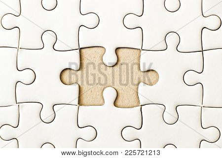 Closed Up Background Of White Plain Jigsaw Wait Missing Piece To Match Or Fulfill