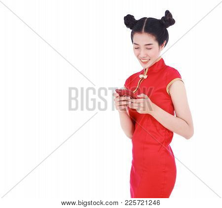 Happy Woman Wear Cheongsam And Using Mobile Phone Isolated On White Background
