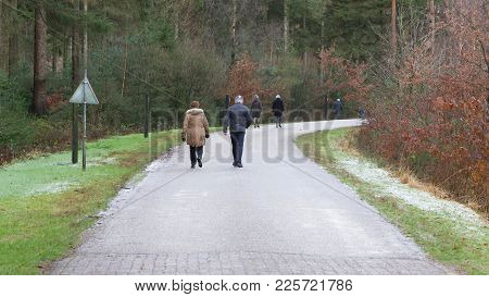 Unrecognisable Couple Walking On A Street In The Netherlands