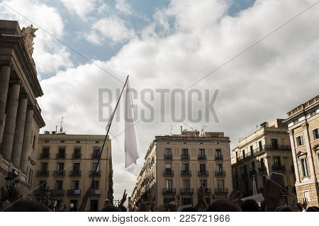 Mass Protest On The Streets Of A European City With People With Their Hands Up And A White Flag In T