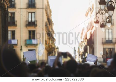 Massive Protest In The Street With Everything Out Of Focus Except The Blank Banners To Be Able To En