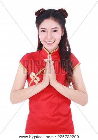 Woman Wear Red Cheongsam And Pay Respect In Concept Of Happy Chinese New Year Isolated On White Back
