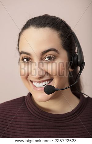 Happy Smiling Attractive Young Woman Wearing A Headset In A Concept Of A Call Center Operator, Custo