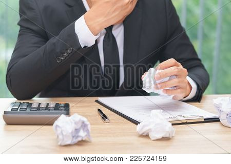 Stressed Businessman Crumple Paper With Calculator And Contract Document - Making A Mistake Concept