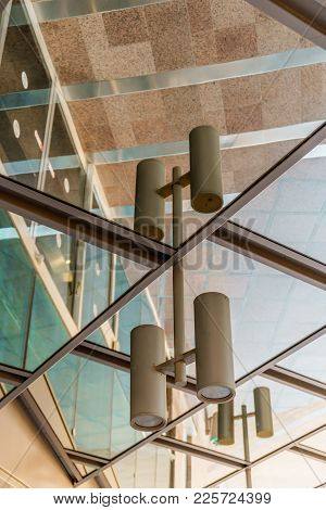 Beautiful Architecture Outdoor Mirror Reflection On The Street. Modern Business Building With Glass