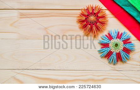 Module Origami Flowers With Paper On Wooden Background