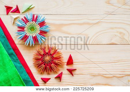 Module Origami Flowers With Paper And Modules On Wooden Background