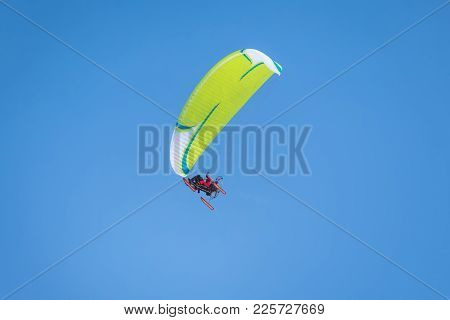 Powered Parachute Against The Blue Sky