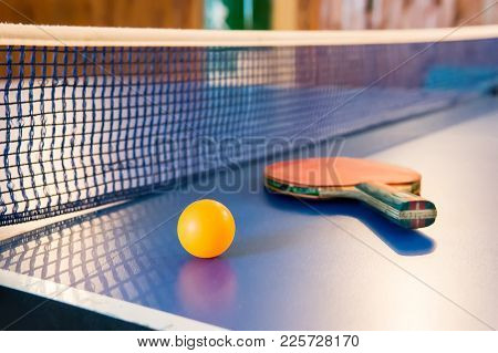 Table Tennis - Racket, Ball, Table. Tabletennis Or Ping Pong Rackets And Yellow Balls On Blue Table.