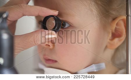 Child In Ophthalmology Clinic - Optometrist Diagnosis Little Blonde Girl, Close Up