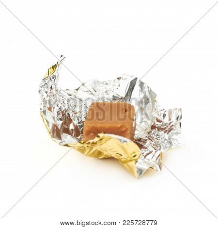 Scottish Fudge Candy In A Golden Wrapper Isolated Over The White Background