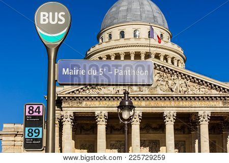 Paris, France - July 03, 2017: Pantheon Bus Stop Sign With The Pantheon In The Background In The Sum