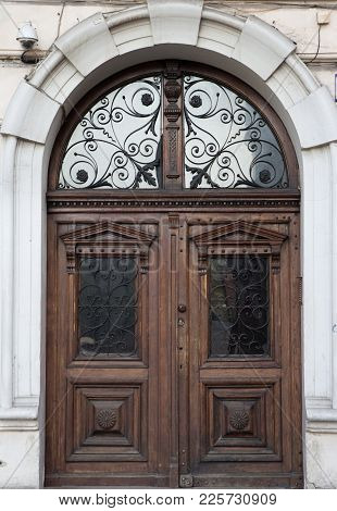 Vintage Wooden Brown Door Close-up With Insertions And Patterns On Glass