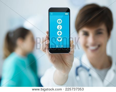 Female Doctor Holding A Smartphone