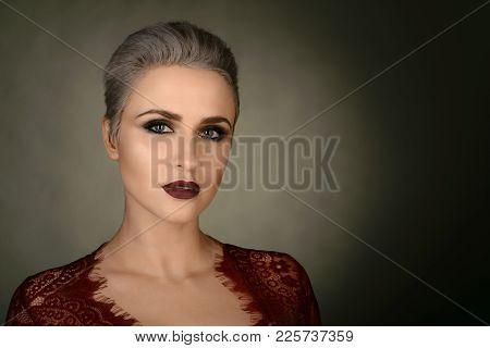 Young Woman Portrait. Closeup Beauty Studio Shoot. Healthy Clean Skin And Perfect Makeup On Beautifu