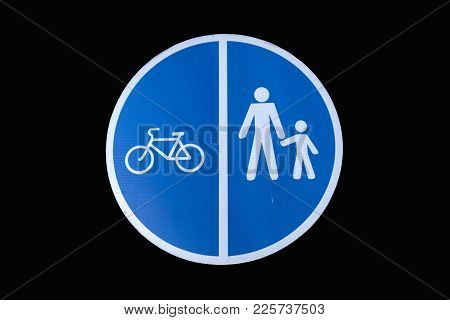 Pedestrian And Bicycle Shared Road Sign Isolated On Black. Road Sign For Pedestrians And Cyclists Wh