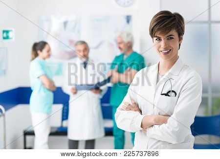 Medical Team Posing At The Hospital And Young Doctor