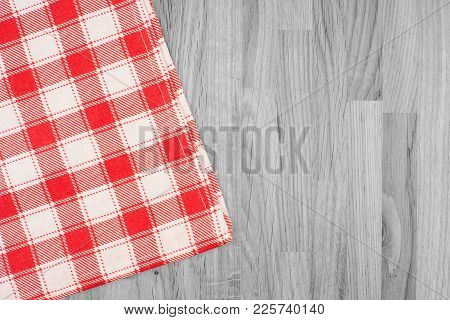The Checkered Tablecloth On Wooden Table. Abstract Background, Empty Template. Top View.