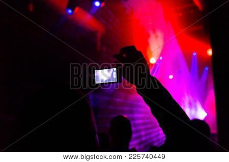Man Taking Photo Mobile Phone Of Silhouettes Crowd