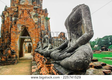 Sitting Buddha - A Temple In Ayutthaya In The Ruins Of The Royal Temple, Which Is The Most Important