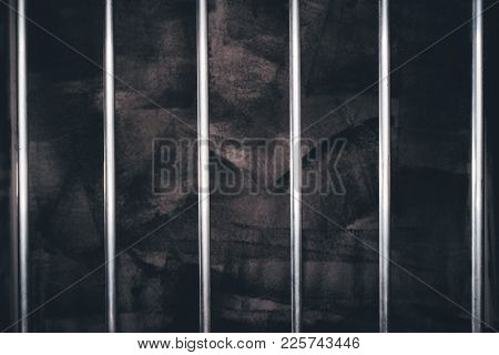 Jail Bars, Empty Dark Prison Cell As Conceptual Background For Crime And Punishment