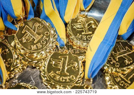 A Lot Of Gold Medals With Yellow Ribbons On A Silver Tray, Awards Of Champions, Sport Achievements,