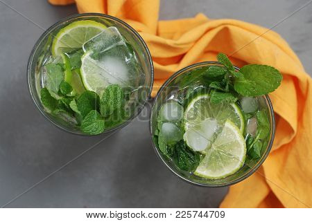Mohito Alcohol Drink. Two Glasses With Cocktail Drinks And Ice Cubes