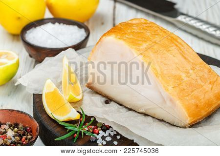 Salted White Fish With Lemon, Rosemary And Spices Salt And Pepper.  Butterfish. Halibut. Snack For G