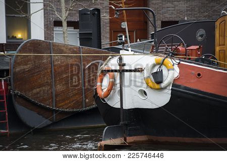 A Docked Backside Of A Ship With Lifebouys Attached To The Backside In The Harbor Of Leiden