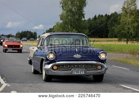Somero, Finland - August 5, 2017: Classic 1950s Oldsmobile 88 Car Moves Along Rural Highway On Maise